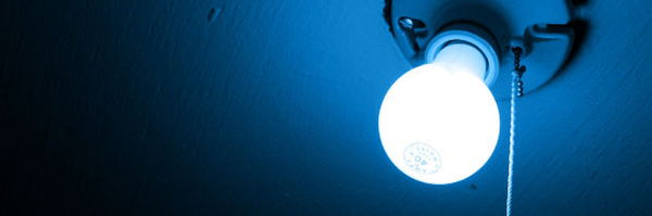 light bulb on in dark room