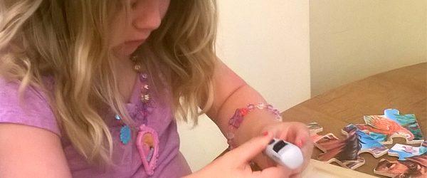 girl checking her blood sugar