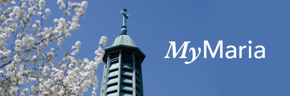 My Maria text in sky in front of Marian Hall chapel