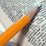 pencil on dictionary