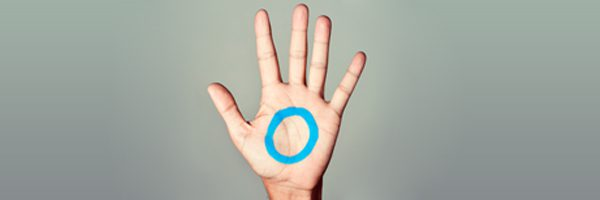 blue circle painted on the palm of a hand