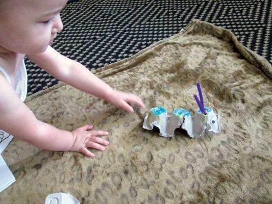 Kori Tomeldon's baby playing with a handmade toy