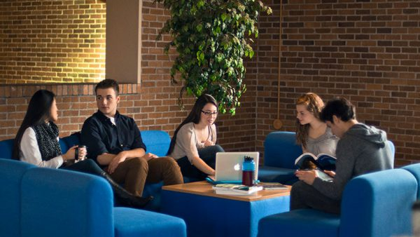 students in student lounge studying