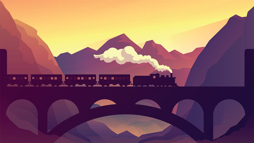train going over bridge during sunset in a valley of mountains