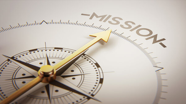 an arrow on a compass pointing towards the words mission
