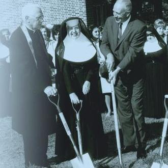 Photo of Bishop Scully, Morther M. Magdalena, Mayor Erastus Corning II, and Mother M. Borromeo breaking ground for the expansion of Maria College.