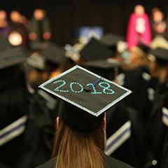 Graduate wearing a 2018 graduation cap