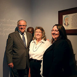 President Tom Gamble, Marie Henderson, RSM, and Vice President Victoria Battell, RSM