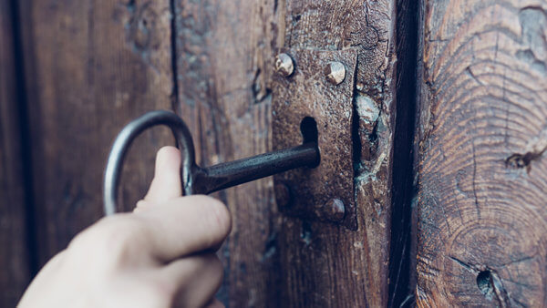 opening a wooden door with a skeleton key