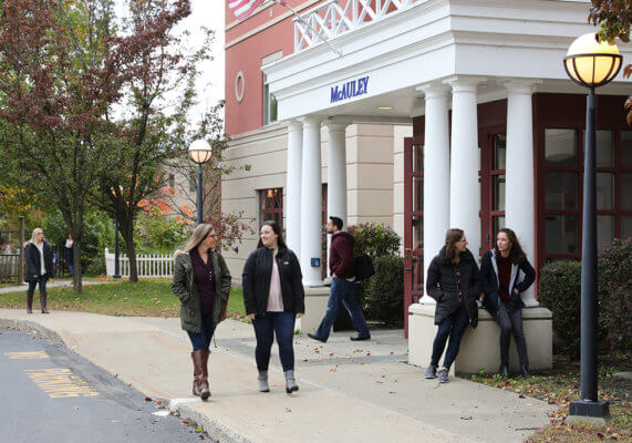 students in front of McAuley Building