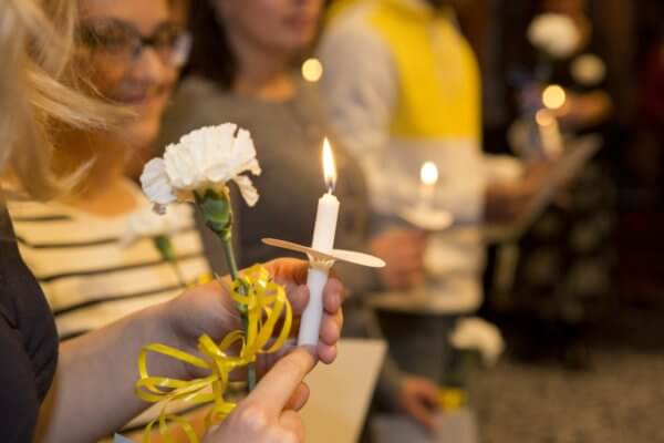 close up on lit candle during Phi Theta Kappa induction ceremony