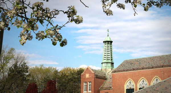 Marian Hall steeple surrounded by spring blossoms