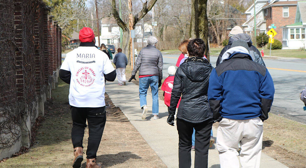 people waling along New Scotland Avenue during the Walk for Mercy event